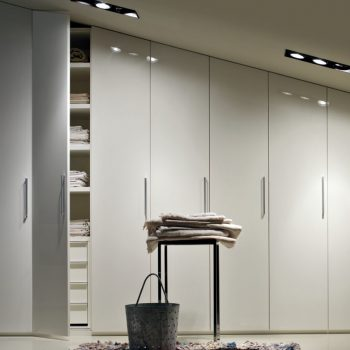 fitted high gloss painted wardrobe slopping ceiling loft room