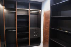 Custom walk in closet with fitted shoe drawers in London