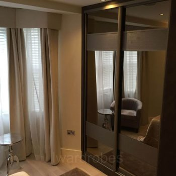 Modern made to measure mirror sliderobe with leather inserts