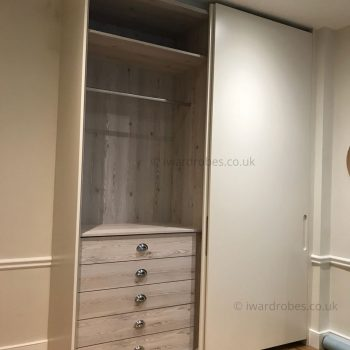 Elegant fitted wardrobe with spray-painted matt sliding doors