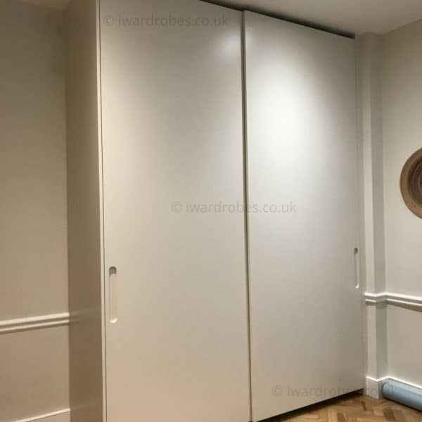 Fitted sliding wardrobe with spray-painted doors