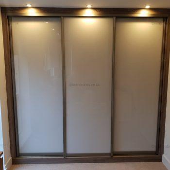 Custom made built in modern sliding door wardrobe in London
